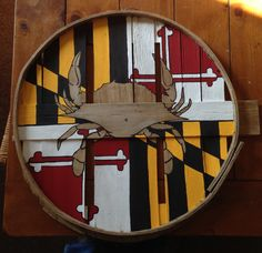Full Maryland state flag background w/  natural wood crab in the center. Painted on recycled crab bushel lid. DettasDelight at Etsy.com