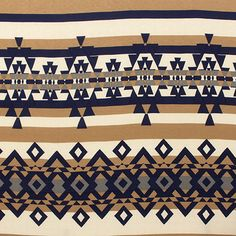 "Beige Navy Navajo Stripe Cotton Jersey Blend Knit Fabric - Neutral tone colors of navy blue and beige navajo ethnic diamond stripe print on a soft off white cotton jersey rayon blend knit.  Fabric has a nice stretch, light to mid weight, and a good drape.  Blue diamond measure 1 1/4"".  ::  $6.00"
