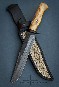 Not a big fan of the snakeskin on the sheat, but what a knife!