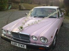 Pink Jaguar wedding car from Lady Penelope Cars