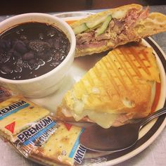 Cubano panini made with honey ham, smoked pulled pork, disjoin sauce, Swiss cheese and homemade pickles, served with black bean soup. Only at Rosemary's Kitchen!