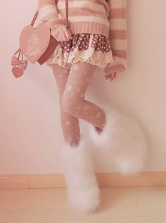 I want this whole look.  Fur boots, cute tights, adorable lacy skirt and a super comfy sweater.  Hello winter!