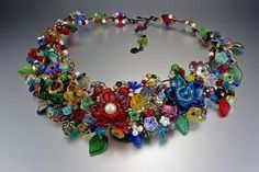 Jewelry Artist Mary Lowe's cuffs are entirely handmade, including the base, from wire and glass beads, pearls and crystal. They can be shaped to conform comfortably to the wearer's wrist. Featured in Beadwork Magazine.