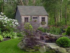 Storybook Cottage:   A lush grass pathway leads around a rock-lined pond and toward the quaint shed. Posted by Rate My Space contributor tumbestere.