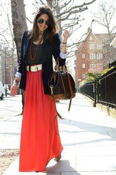 Bright red maxi skirt, navy blue vest.