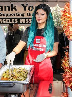 Star Tracks: Friday, November 28, 2014 | DIG IN | Trading the red carpet for a red apron, Kylie Jenner serves up dinner for the homeless Wednesday at Los Angeles Mission's Thanksgiving celebration.