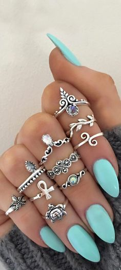 I definitely wouldn't wear this many at once, but I love the rings and the nails!!! - Ashley!