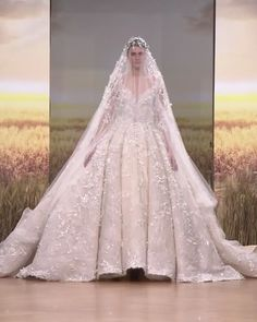 Ziad Nakad Look Spring Summer 2018 Haute Couture Collection Uniq Embellished Wedding Dress / Bridal Ball Gown with V-Neck Cut, Long Sleeves, Open Back, Embellished Veil and Long Train. Runway Show by Ziad Nakad Wedding Dress With Veil, Wedding Dress Trends, Princess Wedding Dresses, Long Wedding Dresses, Bridal Dresses, Gown Wedding, Ball Dresses, Ball Gowns, Couture Collection