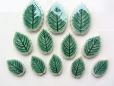 12  Handmade Ceramic leaves with veins, fantastic for adding that unique touch to mosaics or similar projects   There are 3  x approx. 3cm long x 1.7 wide ,   4 x  approx. 3.6cm long  x 2.5 wide and 5 x 2.3cms  long .  All approx. 3mm thick (so will work well with most other mosaic tiles) I cut all my mosaic tiles and buttons from good quality clay and twice fire to very high temperatures to make them more durable and able to withstand outdoor conditions (although care should be taken in…