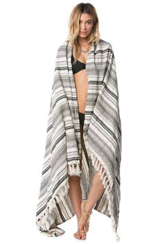 Our Del Mar Beach Blanket is a cotton and lurex yarn dyed beach blanket with fringe edge detail.