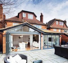 Dark powder-coated aluminium bifold doors and windows