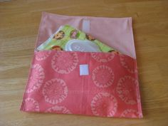 Harriet Homemaker Strikes Again:  Diaper Clutch (Tutorial link in blog post. Tutorial by Violet at Violet Craft for Sew Mama Sew.)