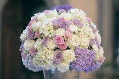 Tablecentre arrangement of white, pink and purple flowers including roses and hydrangea. Groomswear by Louis Copeland & Sons. Photography by: Ros from Couple Photography. Wedding Blog, Wedding Photos, Pink And Purple Flowers, Wedding Table Decorations, Real Weddings, Destination Weddings, Wedding Couples, Couple Photography, Wedding Bouquets