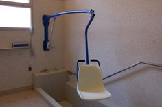 Wall mounted BluOne F130 Swimming Pool Lift -- Dolphin Mobility Ltd. Also available with sling attachment.
