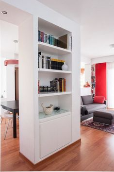 This simple yet chic bureau closet is perfect for separating the apartment entrance from the living room. By Paolo Fusco Photo. # Modular furniture by homifywohnideen Modular Bookshelves, Bookcase, Indian Home Interior, Home Interior Design, Apartment Entrance, Halls, Hall Design, Modular Furniture, Home Look