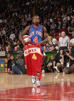 46a3fe28b Nate Robinson of the New York Knikcs walks over to former dunk champion Spud  Webb to present him with a Spud Webb Atlanta Hawks jerseyof the attempts.