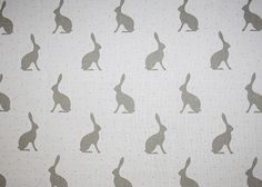Mini Hares Fabric A printed fabric with gently faded hares in olive brown on a natural linen.