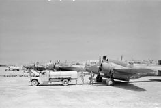 Luqa, Malta, July 1943: a line of Martin Baltimore Mark IVs of No. 223 Squadron RAF Detachment being refueled and loaded with bombs for a raid on enemy positions around Catania, Sicily