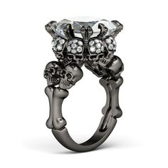 A dead man has neither relations nor friends. - Old French proverb. Image: Princess Cut Created White Sapphire Rhodium Plated Sterling Silver Four-Skull Design Skull Ring