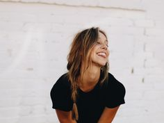 portrait smile smiling smiles girl happy happiness white brick wall city