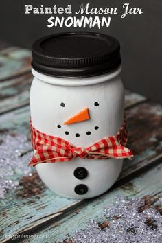 Im slightly obsessed with Mason jars right now and because my Santa Painted Mason Jar was such a hit I decided to craft a different gift that can be given all winter long with this DIY Snowman Jar. Mason Jar Snowman, Mason Jar Christmas Crafts, Noel Christmas, Holiday Crafts, Christmas Gifts, Snowman Soup, Santa Gifts, Rustic Christmas, Diy Snowman Decorations