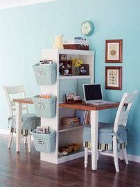 Office space idea for two.  Uses a bookshelf to organize and divide the space