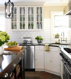 Don't be afraid to mix and match cabinet finishes with your kitchen island and built-in cupboards.