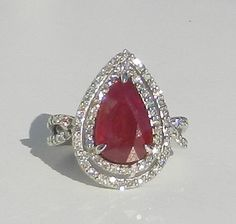 Ruby and diamond ring from bluefirejewelry@etsy.