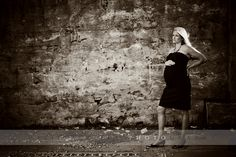 Just because you are about to be a mama...doesn't mean you have lost your edge!  Chose a simple black dress and a great urban location!  Maternity Portraits by Melissa Rieke Photography