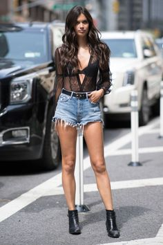 Sara Sampaio arrived for her Victoria's Secret fashion show fitting wearing a sheer top, denim cut-offs and ankle boots.