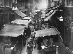 Berwick Street Market, Photograph: (1933). A city space and a city I have known all my life - Its often surprising how much a designer draws on his sub conscious memories  - its often more reliable than the conscious, cluttered mind- even though its Paris I am trying to conjure in the audience's minds its inevitable that theres some bleed through from all those tiny details of ones own sense of place.