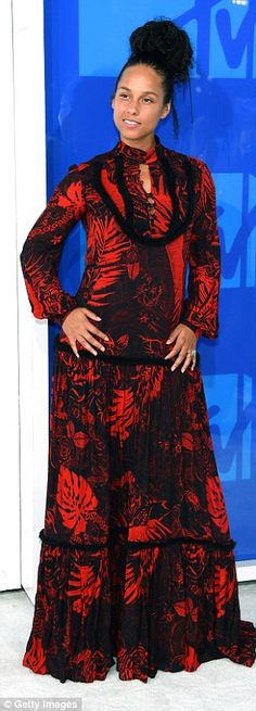 Be bold in a black and red maxi dress #DailyMail