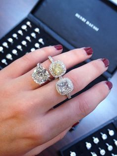 Henri Daussi.. I'll take the middle finger one :)  www.diamonds-usa.com