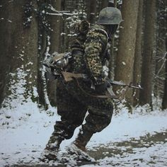 SS Soldier with  Sturmgewehr 44 (StG 44) Pz.Gren.Rgt. 26 in action. 12. SS-Panzer-Division Hitlerjugend during the Battle of the Bulge.