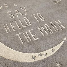 "When bedtime rolls around, it's important to have a motto. We think ""Say Hello to the Moon"" is perfect. Plus, it looks much better on a rug than ""Stop giggling and go to sleep!"""