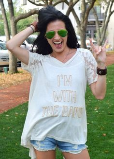 "You have to love Judith March's individuality and flare for fun! Oatmeal Flowy Raglan Short Sleeve Top with ""I'm with the Band"" in gold beads. Made in USA"