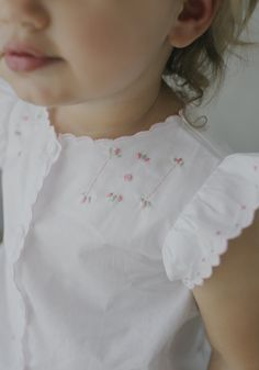 Hand-sewn French knots on this Tea Blouse by Little English have us gushing! Baby Girl Dress Patterns, Baby Clothes Patterns, Little Girl Dresses, Smocked Baby Clothes, Baby Girl Dress Design, Vintage Baby Dresses, Sewing Patterns, Vintage Baby Clothes, Sewing Tutorials