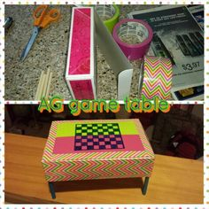 With a few craft supplies,  transform an ordinary box into a coffee table for American Girl. Supplies: empty box,  colored duck tape, dowel, paint, hot glue and sharpie