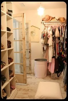 Vintage Closet - salvaged doors, a vintage chandelier, distressed wood floors and trim molding around the wall cubbies. Salvaged materials are a great way to add your personality and can save the homeowner a lot of money on a remodel. Baños Shabby Chic, Shabby Chic Bedrooms, Shabby Chic Homes, Distressed Wood Floors, Distressed Furniture Painting, Vintage Closet, Dream Closets, Bedroom Closets, Bathroom Shelves