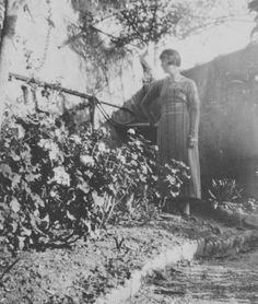 Katherine Mansfield standing in the garden at the Villa Isola Bella at Menton, France, 1920 Katherine Mansfield, Bloomsbury Group, Literature, The Past, Writers, Pictures, Photos, Flower Girls, Matilda