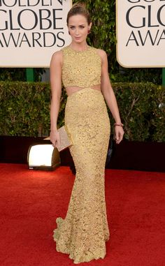 Emily Blunt from Sleek Style! Super Polished Red Carpet Looks  The actress look striking and columnar in her cutout gold Michael Kors gown at the Golden Globes.