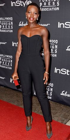 Lupita Nyong'o in Veronica Beard jumpsuit, Calvin Klein clutch, Paul Andrew shoes - At the Hollywood Foreign Press Association and InStyle annual celebration during the Toronto International Film Festival.  (2013)