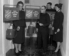 f/8 & Be There: Dec. 3, 1963 Southeast Missourian — Getting Salvation Army kettles ready for the annual Christmas street collections are, from the left, Mrs. Rose Nanna, David Dalberg, Capt. and Mrs. Lee Hickam, corps officers. The funds go for relief work.