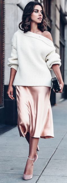 Annabelle Fleur + gorgeous silk slip dress + off the shoulder knitted sweater + sophisticated yet cosy winter look + minimal jewellery + heels + stripped back, feminine look.   Brands not specified.
