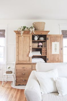 A gorgeous antique armoire decorated for spring in a lovely, little farmhouse. See more photos at LoveGrowsWild.com