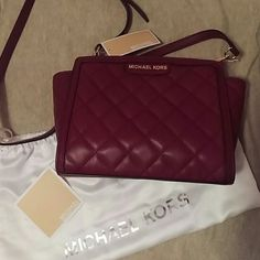 Michael Kors Selma Quilted Messenger Selma Medium Messenger in Claret. This style is no longer available. This bag is a head turner! No low balls, I'd rather keep this bag than get less than what I paid. It's hard not to fall in love with this bag! MICHAEL Michael Kors Bags Crossbody Bags