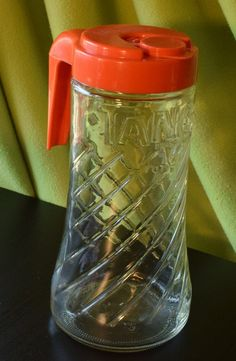 Vintage 1960s TANG Pitcher. This is a nice piece perfect for the collector of vintage brand items. The word TANG is embossed on the pitcher and the iconic orange plastic lid is in excellent condition. There are no chips, cracks or etching of the glass.   Payment  I accept Paypal, credit cards through direct checkout, Etsy gift cards & money orders. Payment with money orders due within 7 days. If you need extra time for some reason, please contact me. I can be flexible, but only if I hear…