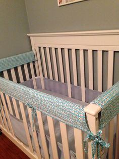 Handmade crib rail guard for teething babies! My mom made with organic cotton fabric and chemical-free batting...safe for little mouths. :)