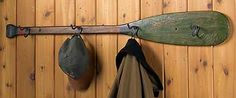 I have an old paddle. Put hooks in it and hang photos from it instead of hats and coats.