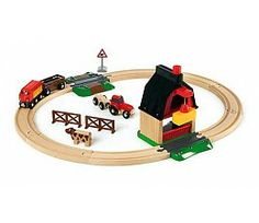 The Brio Farm Railway Set, age guide 3 years plus. A single loop track, a double height barn with a crane that slides out to load bales of hay onto the wagon or trailer for transportation around then farm by train or tractor. Brio Train Set, World Farm, Wooden Train, Starter Set, Train Tracks, Classic Toys, Model Trains, Wooden Toys, Kids Toys